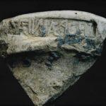 Frammento romano con iscrizione